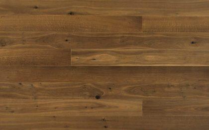 Dębowe deski podłogowe Firenze o wyjątkowej tonacji i szczotkowanej powierzchni.